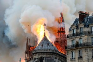 Smoke and flames rise during a fire at the landmark Notre-Dame Cathedral in central Paris on April 15, 2019, potentially involving renovation works being carried out at the site, the fire service said. (Credit: FRANCOIS GUILLOT/AFP/Getty Images)