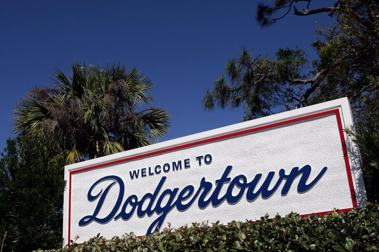 """A """"Welcome to Dodgertown"""" sign is seen during the Los Angeles Dodgers' spring training game against the Florida Marlins on March 2, 2005, in Vero Beach, Florida. (Credit: Ronald Martinez / Getty Images)"""