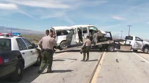 A travel van involved in a crash in Lancaster is towed from the scene April 6, 2019. (Credit: KTLA)