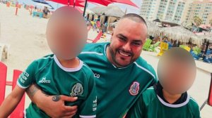 David Flores Ramos is seen with his two sons in an undated photo provided by family.