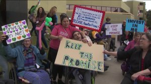 Demonstrators demand increased funding for serviced to help the disabled at a protest outside the state building in Van Nuys on April 5, 2019. (Credit: KTLA)