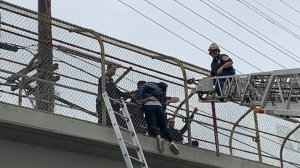 Alhambra police officers and firefighters rescued a suicidal woman from an overpass of the 10 Freeway in Alhambra on April 20, 2019. (Credit: Alhambra Fire Department)