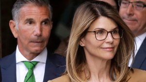 Fashion designer Mossimo Giannulli, left, leaves a federal courthouse in Boston behind his wife, actress Lori Loughlin, on April 3, 2019. (Credit: Pat Greenhouse / The Boston Globe via Getty Images)