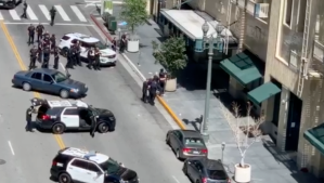 Los Angeles Police Department officers responding to the scene of an officer-involved-shooting in downtown Los Angeles on April 14, 2019. (Credit: Dennis Jaurigue)
