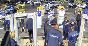 Daniel Antunez is seen surrounded by security guards outside the Dodger Stadium on April 24, 2018, in surveillance video from stadium provided by the diDonato Law Center.