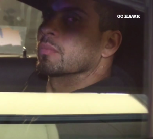 The pursuit suspect is seen after his arrest in sitting in the back of a patrol car in Rowland Heights on April 24, 2019.