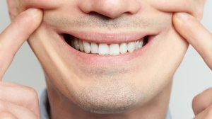 A person is seen smiling in this file image. (Credit: Shutterstock)