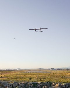 The Stratolaunch, the world's largest plane, flies alongside another aircraft over the Mojave Desert on April 13, 2019. (Credit: Stratolaunch)