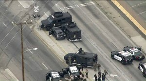 Armored vehicles surround the suspect's car in Vernon on May 10, 2019. (Credit: KTLA)