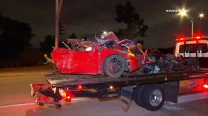 The mangled wreck of a totaled Lamborghini was hauled away by a tow truck on May 16, 2019. (Credit: AMG News)
