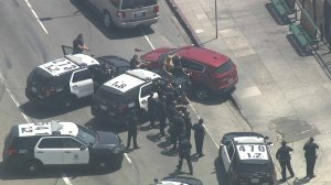The suspect involved in a police chase is taken into custody in South Park on May 30, 2019. (Credit: KTLA)