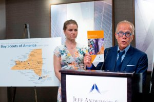 Bridie Farrell (L), a survivor of abuse and co-founder of NY Loves Kids, listens to victims' rights Attorney Jeff Anderson (L) as he speaks at a press conference on April 23, 2019, in New York. Anderson discussed allegations of child abuse against the Boys Scouts of America (BSA) which were reported April 22, 2019. The accusations were revealed and the names of some 130 of the alleged abusers were to be released. Anderson claims the BSA has files on abusers dating to the 1940s. (Credit: EDUARDO MUNOZ ALVAREZ/AFP/Getty Images)
