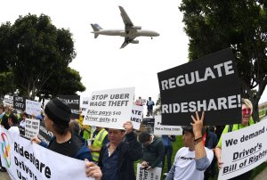 Drivers for Uber and Lyft stage a strike at Los Angeles International Airport over what they say are unfair wages on May 8, 2019. (Credit: Mark Ralston / AFP / Getty Images)