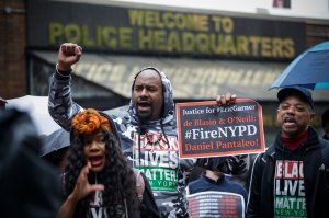 People protest outside the police headquarters while a disciplinary hearing takes place for officer Daniel Pantaleo on May 13, 2019, in New York City. (Credit: Kena Betancur / AFP / Getty Images)