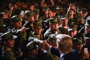 President Donald Trump greets Marines aboard the amphibious assault ship USS Wasp during a Memorial Day event in Yokosuka, Japan, on May 28, 2019. (Credit: Brendan Smialowski / AFP / Getty Images)
