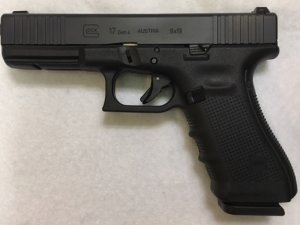 A gun like the one taken from a San Bernardino County Sheriff's deputy's home is seen in an image provided by the Sheriff's Station.
