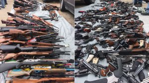 Some of the guns seized during an investigation in Bel-Air are shown in photos released by the LAPD on May 8, 2019.