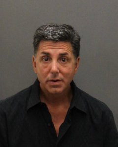 Richard Bloustine, 53, is seen in a May 1, 2019, booking photo released by the Laguna Beach Police Department.