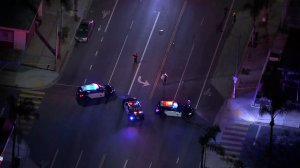 Police respond to the scene where a pedestrian was killed in a hit-and-run crash in Long Beach on May 20, 2019. (Credit: KTLA)