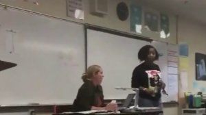 A mother is seen confronting students at Niguel Hills Middle School in a video obtained by KTLA.