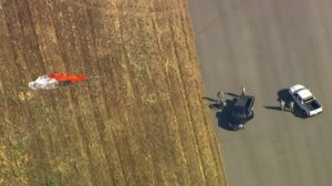 A parachute is seen in a field after a F-16 pilot ejected just before a crash near March Air Reserve Base in Riverside County on May 16, 2019. (Credit: KTLA)