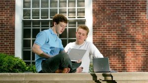 Chris Hughes is seen with Mark Zuckerberg in this undated photo obtained by CNN. Hughes helped transform Facebook from a dorm-room project into a real business. Now, he's calling for the company to be broken up.