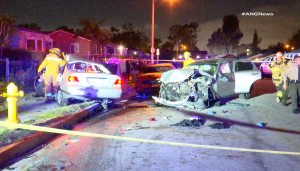 Officers assess two mangled vehicles that had collided in South Los Angeles' Willowbrook neighborhood on May 11, 2019.