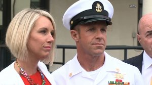 Navy Special Operations Chief Edward Gallagher, right, stands alongside his wife, Andrea Gallagher, after being released for custody on May 30, 2019 in San Diego. (Credit: KSWB via CNN)