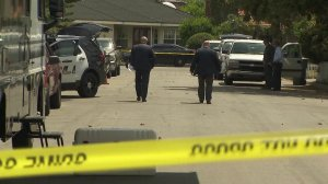 Authorities investigate the death of a 76-year-old woman found in her Arcadia backyard on April 9, 2019. (Credit: KTLA)
