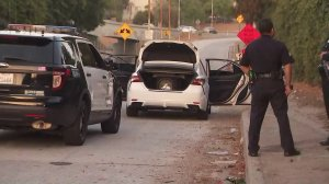A car involved in a police shooting in Boyle Heights is seen after the driver was apprehended near the 101 Freeway on June 5, 2019. (Credit: KTLA)