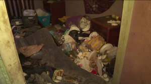 Trash covering a room in the Vermont-Slauson building where 40 people were evacuated on June 21, 2019. (Credit: KTLA)