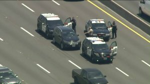 CHP officials box in a driver along the westbound 101 Freeway who was eluding authorities on several highways on June 12, 2019. (Credit: KTLA)