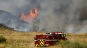 A brush fire burns in Moreno Valley on June 21, 2019. (Credit: Cal Fire)
