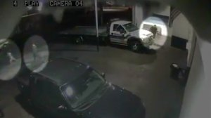Two suspects, including one who appears to be a child, are pictured in the left side of this surveillance camera image that captured portions of the fatal June 28, 2012, shooting of tow truck driver Robert Garcia, 22, of Norwalk. The victim, Garcia, is pictured at top right. (Credit: Los Angeles County Sheriff's Department)