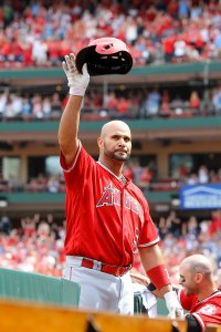 Albert Pujols #5 of the Los Angeles Angels of Anaheim gives fans a curtain call after hitting a solo home run during the seventh inning against the St. Louis Cardinals at Busch Stadium on June 22, 2019 in St. Louis, Missouri. (Credit: Scott Kane/Getty Images)
