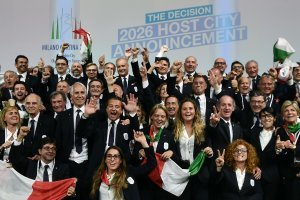 Members of the delegation of Milan/Cortina d'Ampezzo 2026 Winter Olympics candidate city react after the city was elected to host the 2026 Olympic Winter Games during the 134th session of the International Olympic Committee (IOC), in Lausanne on June 24, 2019. (Credit: PHILIPPE LOPEZ/AFP/Getty Images)