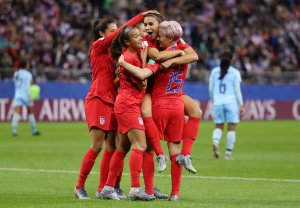 Alex Morgan of the USA celebrates with teammates after scoring her team's twelfth goal during the 2019 FIFA Women's World Cup France group F match between USA and Thailand at Stade Auguste Delaune on June 11, 2019, in Reims, France. (Credit: Robert Cianflone/Getty Images)