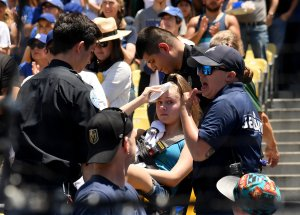 Kaitlyn Salazar is escorted on a stretcher after she was hit by a foul ball off the bat of Cody Bellinger on June 23. (Credit: Harry How/Getty Images)