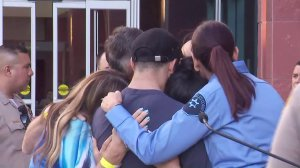 Family and friends of slain Los Angeles County Sheriff's Deputy Joseph Gilbert Solano embrace each other following a press conference announcing his death on June 12, 2019. (Credit: KTLA)