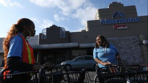 Pamela Hill, 58, right, talks with a co-worker about the possibility of another strike in front of the Albertsons store where she has worked at for the last 23 years in the Crenshaw District in Los Angeles in this undated photo. (Credit: Genaro Molina / Los Angeles Times)