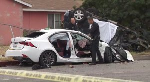 Officials assess the scene of a deadly crash in North Hills on June 16, 2019. (Credit: KTLA)