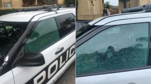 An Oxnard police vehicle is seen after one of its windows was shot out by a gunman on June 20, 2019, in photos released by the department.