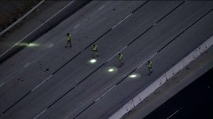 California Highway Patrols officers investigate following a shooting on the 10 Freeway in Pomona on June 28, 2019. (Credit: KTLA)