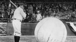 Baseball player Babe Ruth (George Herman Ruth, 1895 - 1948) taking a swipe at an enormous ball. (Credit: Fox Photos/Getty Images)
