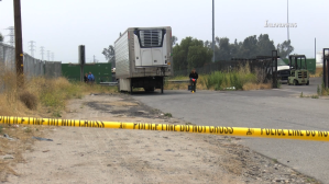 Officials investigate the scene in Colton where a woman's body was dumped after she was shot dead in Fontana on June 25, 2019. (Credit: Inland News)
