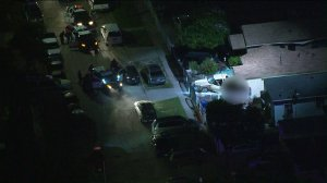 Aerial video from Sky5 captured a tense standoff between Los Angeles police and a gunman in Watts on April 30, 2019. (Credit: KTLA)
