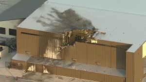 10 people died after an airplane crashed into a hangar at an airport in Addison, Texas, on June 30, 2019. (Credit: CNN)