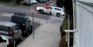 A white pickup with a camper shell is seen as it runs over an elderly man in a Valley Village crosswalk on June 17, 2019, in a still from surveillance video provided by the victim's family.