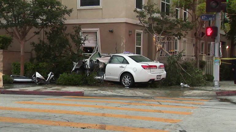 A car crashed into an apartment building in South Los Angeles on July 3, 2019. (Credit: KTLA)