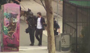 Authorities detain Robert Camou after an hourslong standoff in downtown Los Angeles on July 30, 2019. (Credit: KTLA)